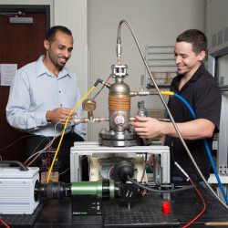 Assistant professor of engineering Kareem Ahmed (left) works with a research student in a lab. (Photo by Bernard Wilchusky)