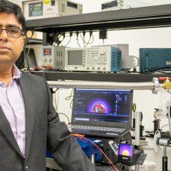 Debashis Chanda, an associate professor in UCF's NanoScience Technology Center, demonstrates improved infrared night vision capabilities.