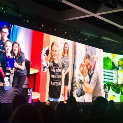 A display of images highlighting the work and impact of Limitless Solutions was displayed during Adobe CEO Shantanu Narayen's talk at Adobe Max 2019.