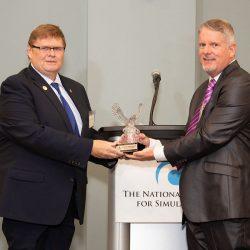 men holding award