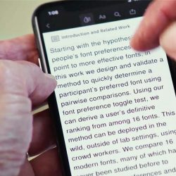 hands holding smart phone with words on it